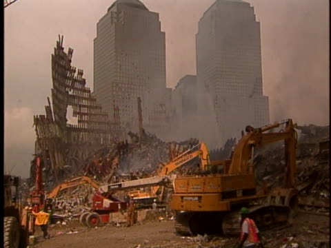 rescue workers use heavy machinery to sift through the rubble at ground zero in new york city. - 2000s style stock videos & royalty-free footage