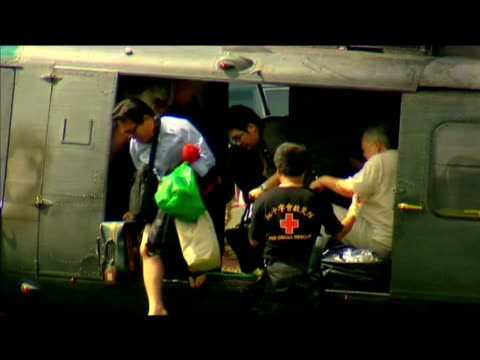 rescued victims of typhoon morakot exit helicopter and walk to safety taiwan 12 august 2009 - taiwan stock videos & royalty-free footage