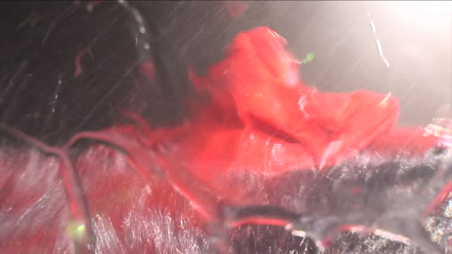a rescuer in an orange dry-suit swims in stormy waters to a sinking ship. - sinking stock videos & royalty-free footage