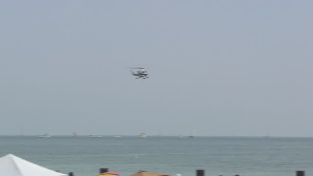 rescuers arrive at practice water rescue at the chicago air and water show on august 17, 2014 in chicago, illinois. - chicago air and water show stock videos & royalty-free footage