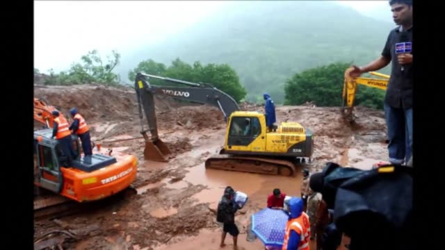 Rescuers battled through heavy rains on Thursday in a desperate search for victims of a landslide at Malin village in Pune district in western India...