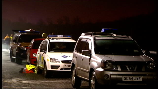 rescuers call off search for three missing sailors in river clyde; scotland: clydebank: ext / fog police vehicles by banks of river police boat with... - itv lunchtime news stock-videos und b-roll-filmmaterial
