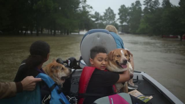 Rescuers help trapped residents escape rising floodwaters in the Highland Glen subdivision outside Houston in Spring Texas US on Monday Aug 28 2017...