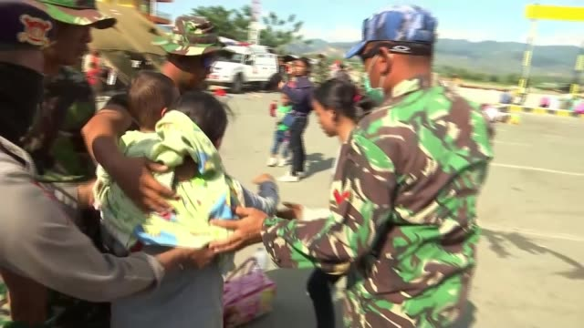 rescuers hopeful of finding more survivors while aid organisations continue to struggle to get supplies to impacted areas indonesia palu crowds of... - push cart stock videos & royalty-free footage