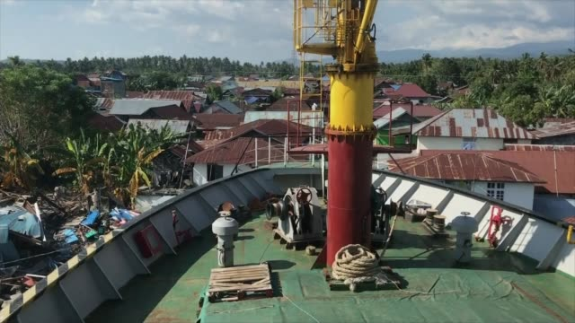 rescuers hopeful of finding more survivors while aid organisations continue to struggle to get supplies to impacted areas indonesia sulawesi island... - indonesia stock videos & royalty-free footage