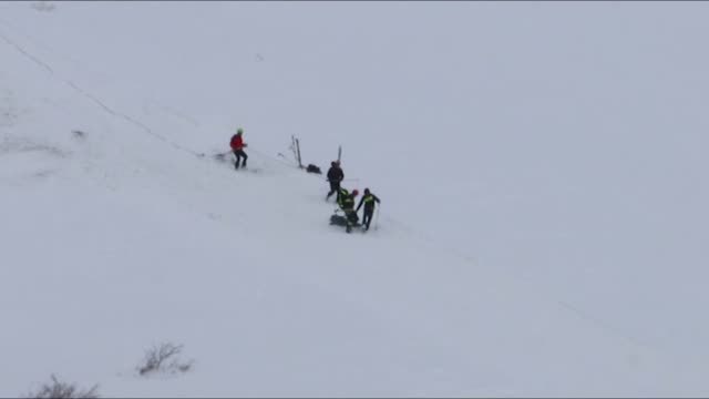 rescuers work near the wreck of an helicopter following a crash that killed six people on january 24 2017 in the mountains near the ski resort of... - rescue worker stock videos & royalty-free footage