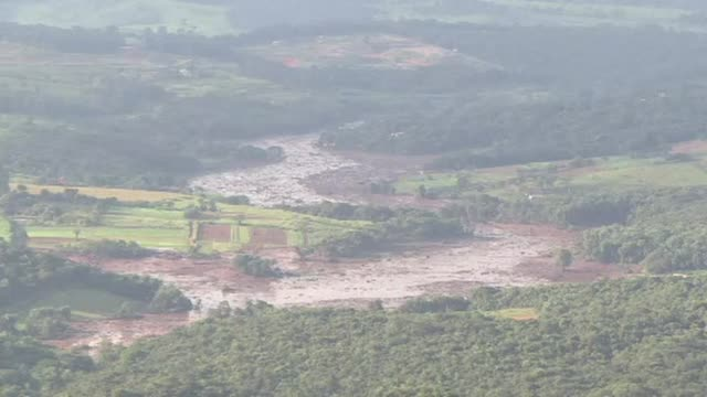rescuers work overnight searching for around 300 people missing after a dam collapse at a mine in southeast brazil killed at least nine but the local... - collapsing stock videos and b-roll footage