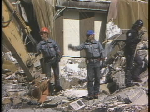 rescuers workers in alta, utah clean up following a propane gas explosion. - ユタ州 アルタ点の映像素材/bロール