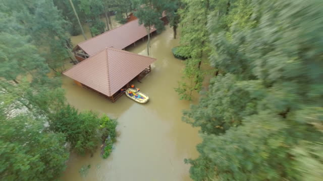 aerial rescuing people from the flooded areas - help single word stock videos and b-roll footage