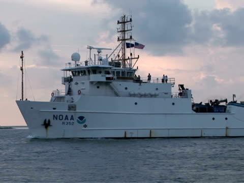 MS, TS, Research NOAA ship moving along coastline