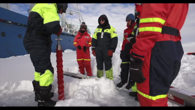 research scientists looking for plastic in ice samples from the norwegian arctic - arctic stock videos & royalty-free footage