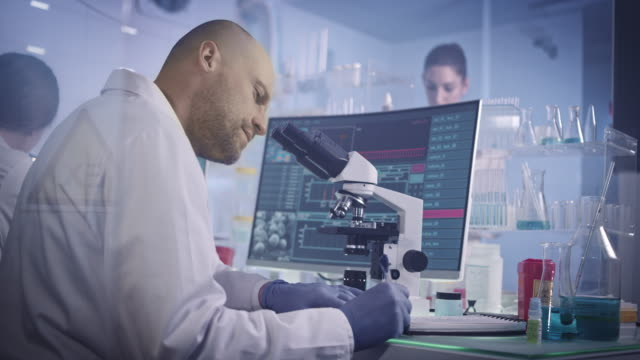 research team studying dna mutations. female doctor in background - cerebrum stock videos & royalty-free footage