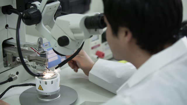 research worker using microscope - microbiology stock videos & royalty-free footage
