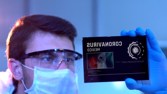 researcher looking at coronavirus results. mexican flag on digital screen in laboratory - latin america stock videos & royalty-free footage