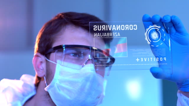 researcher looking at coronavirus results of azerbaijan. azerbaijan flag on digital screen in laboratory - baku video stock e b–roll