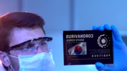 Researcher Looking at Coronavirus Results of South Korea on Digital Screen in Laboratory