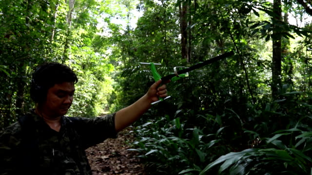 Researcher using radio telemetry/tracking to find an animal