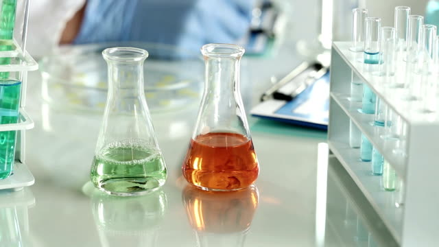 researcher working with chemicals in a lab. - compound interest stock videos and b-roll footage