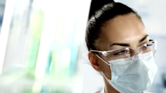 researcher working with chemicals in a lab. - hoozone stock videos and b-roll footage