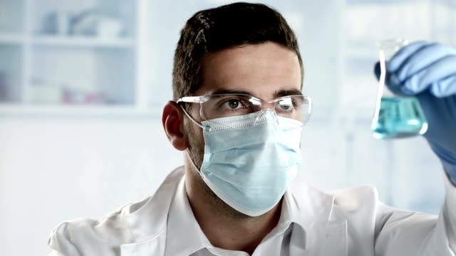researcher working with chemicals in a lab. - pollution mask stock videos and b-roll footage