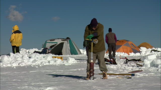 WS Researchers drilling into ice near base camp