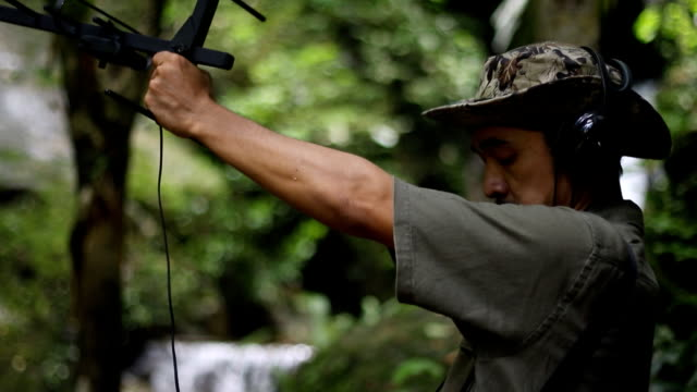 researchers listen to the radio signal from radio telemetry,tracking to find an wildlife in tropical rainforest - climate scientist stock videos & royalty-free footage
