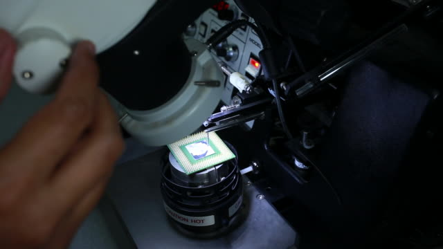 researchers using a microscope in laboratory - electron stock videos & royalty-free footage
