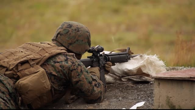 reserve marines with 1st and 3rd battalion 23rd marine regiment competing in the 2018 4th marine division super squad competition conduct a... - sandbag stock videos & royalty-free footage