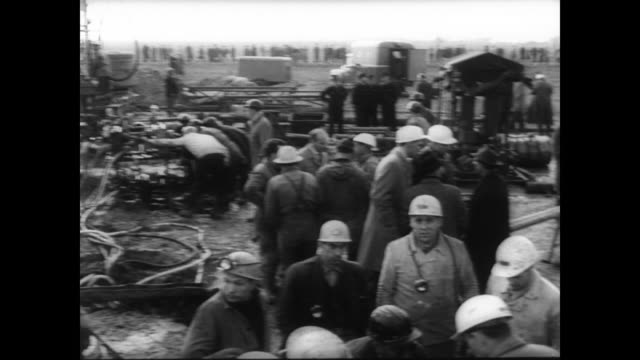 reservoir dam collapse next to the lengedebroistedt iron mine / surface crowd gathering for rescue efforts / women look on / food lowered down... - mine shaft stock videos and b-roll footage