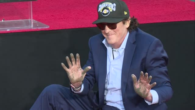 reservoir dogs actor michael madsen places his hands in a block of concrete outside the chinese theater in los angeles, in the first hollywood... - michael madsen stock videos & royalty-free footage