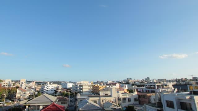ws t/l residence area and sky / naha, okinawa, japan - 屋根点の映像素材/bロール