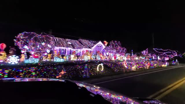 resident of lynchburg, virginia, impressed passersby on saturday, december 12, after packing their front yard with dozens of colorful holiday figures... - vermont stock videos & royalty-free footage
