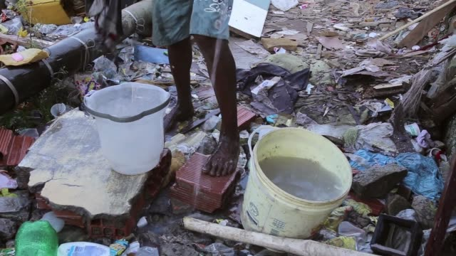 CU A resident of the Mangueira favela washes himself and his clothes Mangueira favela is located right next to Maracana Football Stadium A big part...