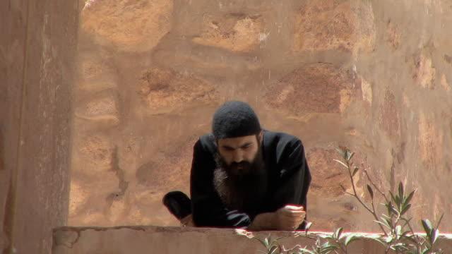 WS ZO LA Resident Orthodox Monk relaxing, Mount Sinai, Egypt