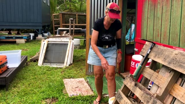 resident stacy welch arranges belongings in the leilani estates neighborhood in the aftermath of eruptions from the kilauea volcano on hawaii's big... - evacuation stock videos & royalty-free footage