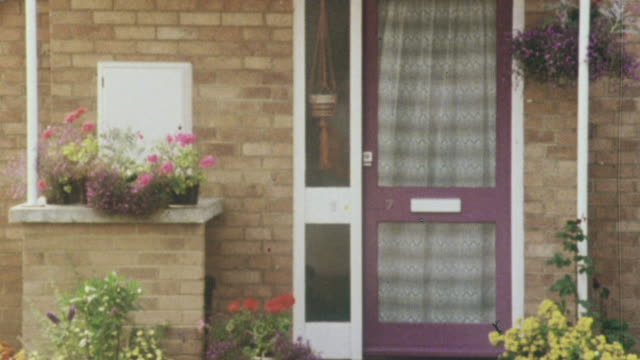 montage resident watering flowers on the home's stoop, housing entrances displaying the resident's personal touch, and milkman delivering to resident's door of terraced housing / united kingdom - 1980 stock videos and b-roll footage