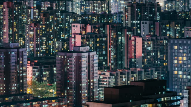 t/l ms ha zi residential area and grid apartment at night - population explosion stock videos and b-roll footage