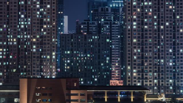 vídeos de stock e filmes b-roll de t/l ms zi residential area at night / beijing, china - blockchain
