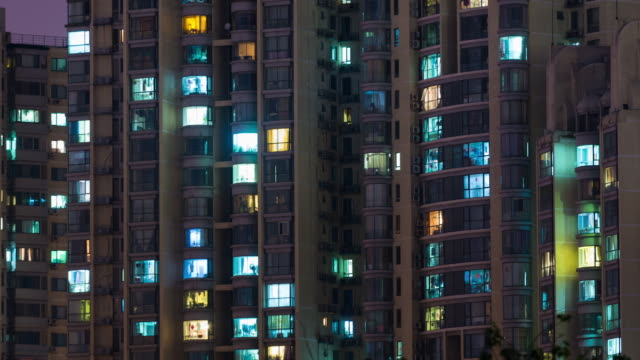 t/l cu ha lr pan residential area at night / beijing, china - appartamento video stock e b–roll