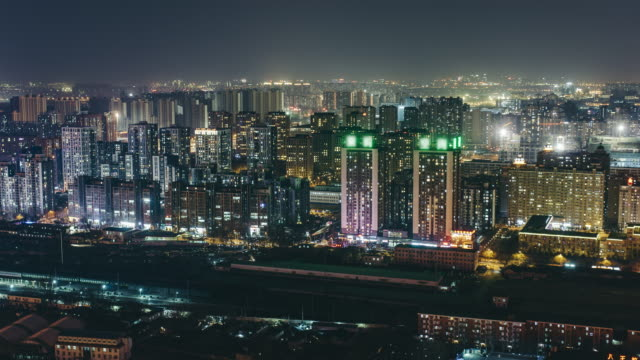 t/l ws ha pan residential area at night / beijing, china - street light stock videos & royalty-free footage