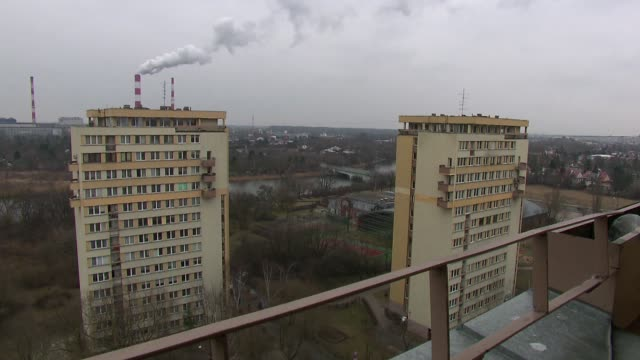 residential blocks with fuming chimneys in background - warsaw stock videos & royalty-free footage
