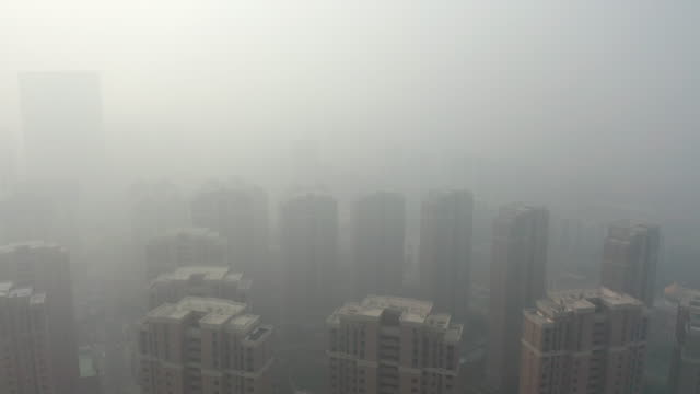 residential building in the fog - pollution stock videos & royalty-free footage