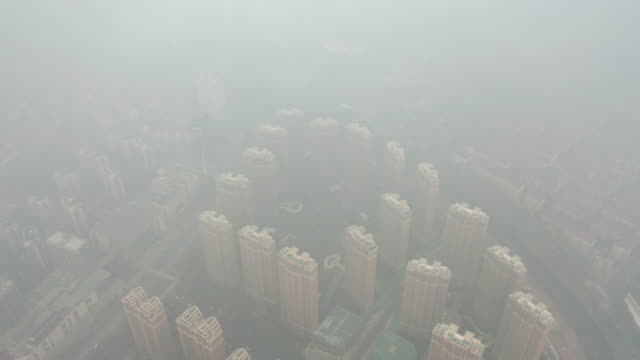 residential building in the fog - smog stock videos & royalty-free footage
