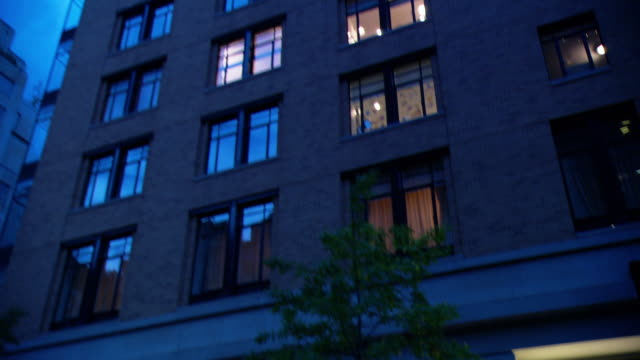 vídeos de stock e filmes b-roll de td residential building, with some windows lit at night, and the front entrance / new york city, new york, united states - portadas