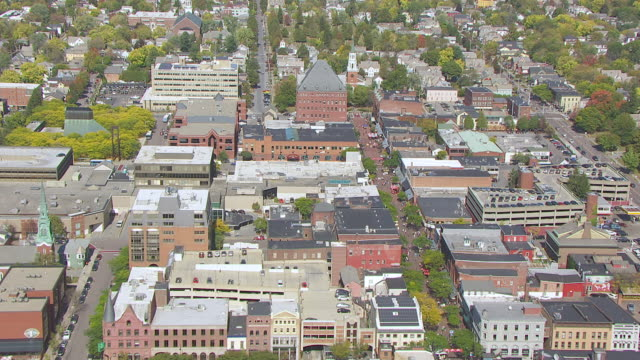 WS AERIAL POV Residential building with traffic on street / Burlington, Vermont, United States
