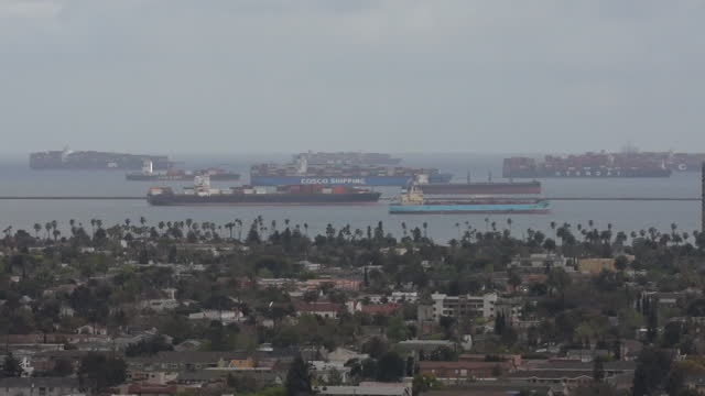 residential buildings and container sips anchored at port of long beach in long beach, ca. u.s. on thursday, march 25, 2021. overwhelmed u.s. ports,... - anchored stock videos & royalty-free footage
