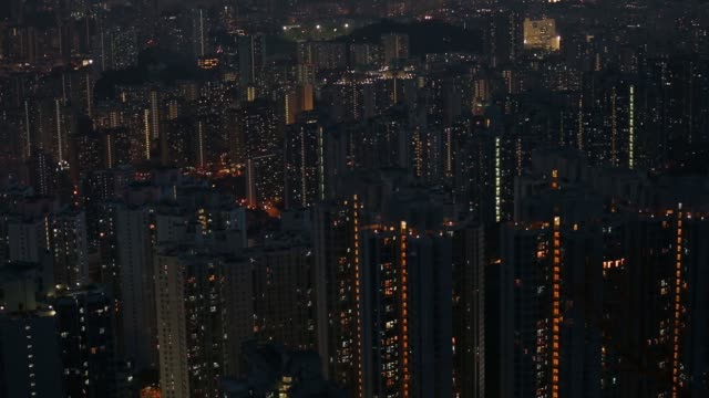 Residential buildings front stand illuminated at night in Hong Kong China on Tuesday Aug 25 Traffic on the Kwun Tong Bypass passes residential...