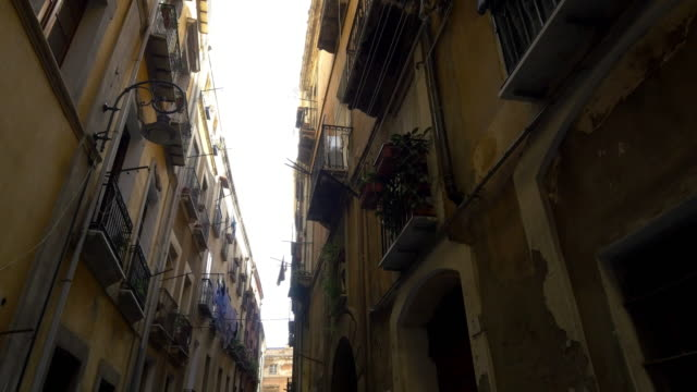 pov residential buildings in narrow street of palermo - sicily stock videos & royalty-free footage