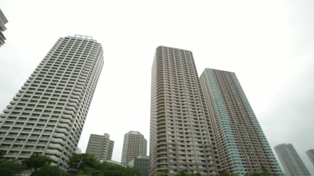 Residential buildings stand along the Sumida river viewed from a sightseeing boat in Tokyo Japan on Thursday July 17 Residential buildings stand...