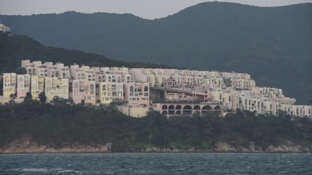 residential buildings stand in the stanley area of hong kong china on friday nov 27 residential houses stand along the redhill peninsula in the tai... - peninsula stock videos and b-roll footage